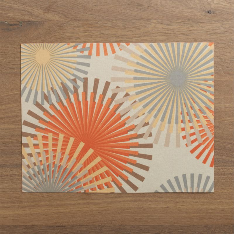 Green from start to finish, this recycled placemat is digitally printed with graphic starbursts in classic mid-century hues on one side and solid orange on the reverse. Eco-friendly dyeing and printing process eliminates major pollutants.<br /><br /><NEWTAG/><ul><li> 100% recycled plastic drinking bottles</li><li> Wipe clean</li><li>Made in USA and Taiwan</li></ul>