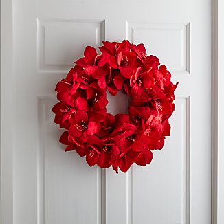 Amaryllis's showy red blooms cluster together in an elegant wreath composed of lifelike blooms.  As a wall hanging or centerpiece, this wreath adds a natural look to seasonal décor.