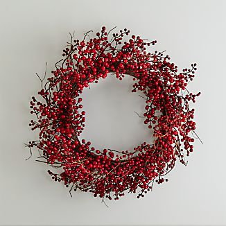 Twigs of faux berries wind a large wreath adding festive color above a fireplace or as a welcoming wall decoration in the foyer.