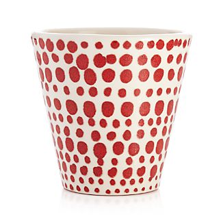 Hand-speckled reactive red dots pepper this ivory terra cotta planter with casual, freewheeling pattern. Each planter will be unique and different.