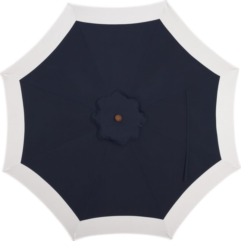 Seek shelter under a smart canopy of indigo banded with natural Sunbrella® acrylic that blocks out 98% of the sun's rays. Fits all of our 9' round frames. Frames and stands sold separately.<br /><br /><NEWTAG/><ul><li>Cover: fade- and mildew-resistant Sunbrella acrylic umbrella (fits all 9' round frames; spot clean)</li></ul><br />