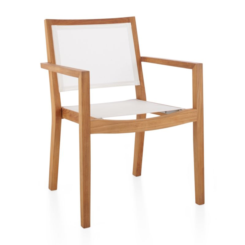 Our exclusive Regatta outdoor dining chair cuts a clean, classic profile in a bold wide-slat design handcrafted of Grade A plantation-grown teak, the highest quality teak in the world. Mesh dining chair features UV- and fade-resistant white Batyline ® inserts. <NEWTAG/><ul><li>Handcrafted</li><li>Solid FSC-certified teak</li><li>Unfinished</li><li>White Batyline synthetic mesh inserts</li><li>Mortise-and-tenon joinery</li><li>Stainless steel hardware</li><li>Stackable</li><li>Made in Indonesia</li></ul><br />