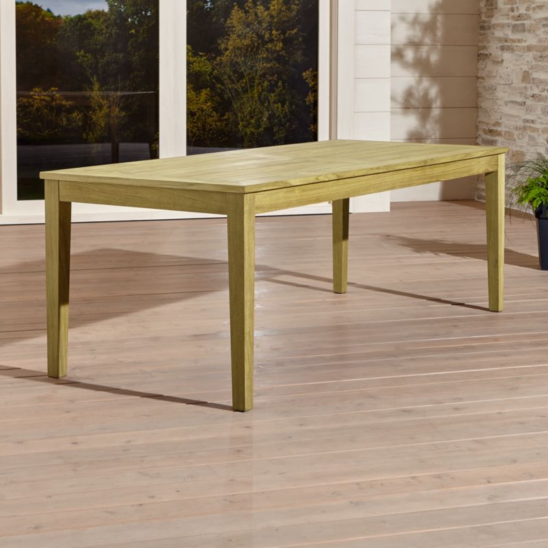 Our exclusive Regatta outdoor collection features a clean, classic profile in a bold wide-slat design. Our Regatta rectangular outdoor dining table is handcrafted of Grade A plantation-grown teak, the highest quality teak in the world. <NEWTAG/><ul><li>Handcrafted</li><li>Solid FSC-certified teak</li><li>Unfinished</li><li>Mortise-and-tenon joinery</li><li>Stainless steel hardware</li><li>Seats up to 8</li><li>Umbrella opening with self-storing plug provided</li><li>Made in Indonesia</li></ul><br />