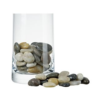 Hand-gathered natural river stones are sorted, tumbled and waxed by hand to provide a natural accent for candle displays, vases and fountains.