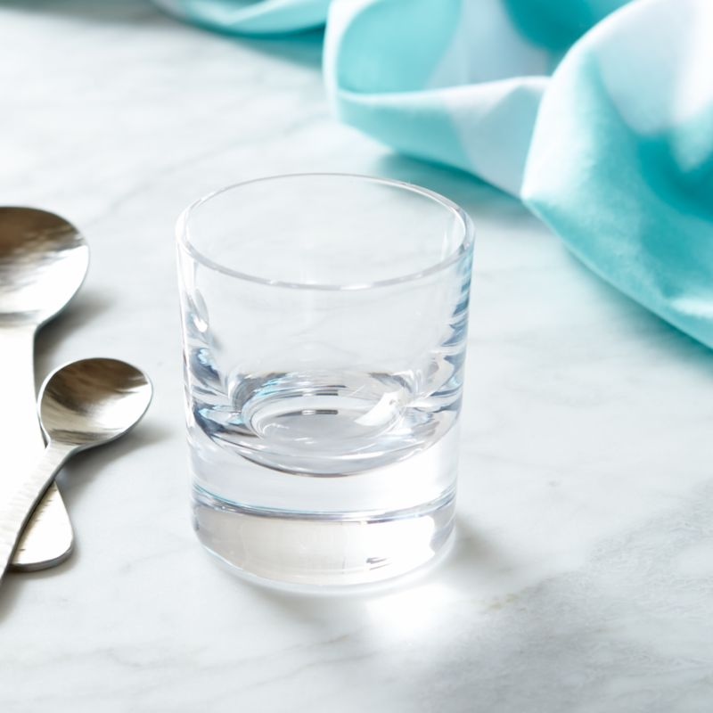 Paola Navone's bold and expressive tableware collection recaptures the lively and energetic 1950s scene of the French Riviera. The inspiration is a cheerful world, remembering the flavors and scents of the sun-drenched Mediterranean. Earthy, elegant beverage glass in a timeless shape speaks to lingering, relaxing sips of icy cocktails or effervescent sodas. Each glass is handcrafted by skilled European glassmakers and stamped with the designer's signature fish logo.<br /><br /><NEWTAG/><ul><li>Designed by Paola Navone exclusively for Crate and Barrel</li><li>Handcrafted</li><li>Glass</li><li>Chip resistant</li><li>Hand wash</li><li>Made in Poland</li></ul>