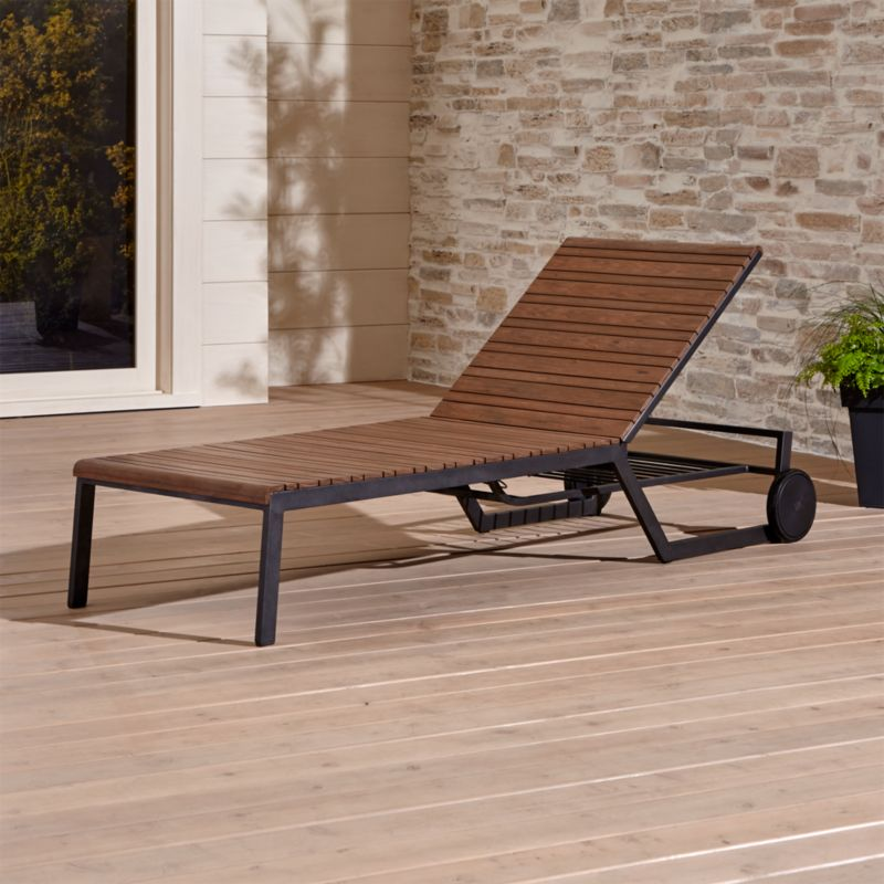 Weather-resistant polystyrene translates the beautiful grain and warm tones of natural Brazilian ipe wood into a stylish collection designed for the great outdoors. Everyone does a double take when they first see our exclusive Rocha collection. What appears to be beautiful Brazilian ipe wood is aligned in alternating wide and thin slats is actually a realistic interpretation in weather-resistant polystyrene faux wood. <NEWTAG/><ul><li> Aluminum with powdercoat finish</li><li>Extruded polystyrene with UV and antioxidant protection</li><li>Adjusts to any position with gas-lift mechanism</li><li>Two rear wheels</li><li>Made in China</li></ul><br />