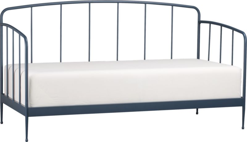 Clean, au courant styling updates the Victorian iron bed frame in modern tubular metal, minimally embellished with a gracefully arched headboard and footboard and a beautiful slate blue powdercoat finish. Foot detail on the tapered legs creates a floating effect. Accommodates a twin mattress, pair with matching trundle bed for spur-of-the-moment overnighters. Mattresses and coordinating trundle bed sold separately.<br /><br /><NEWTAG/><ul><li>Metal tube with blue powdercoat finish</li><li>Accommodates a twin mattress and trundle bed, sold separately</li><li>Slat system</li><li>Made in China</li></ul>