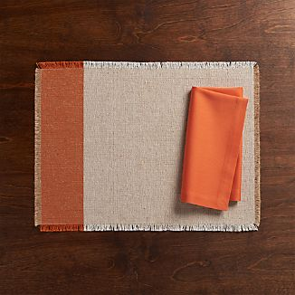 Roscoe Orange Placemat and Fete Coral Cloth Napkin