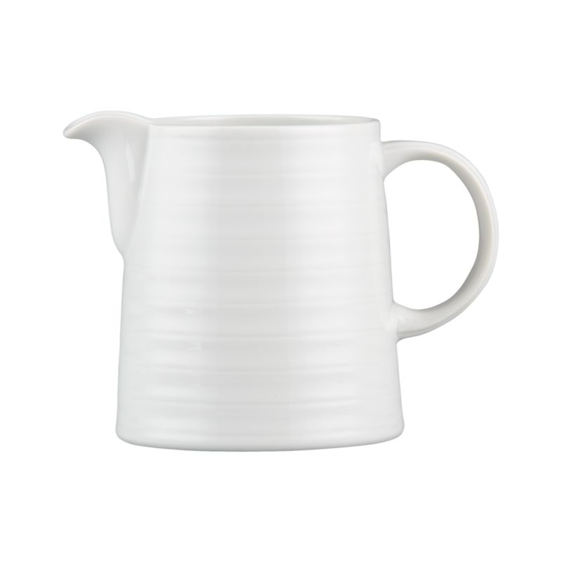 Our Roulette creamer features subtle concentric circles that create a soothing ripple effect in durable, pure white porcelain. Roulette dinnerware also available.<br /><br /><NEWTAG/><ul><li>Porcelain</li><li>Designed by Martin Hunt of Queensberry Hunt</li><li>Dishwasher- and microwave-safe</li><li>Made in Portugal</li></ul><br />