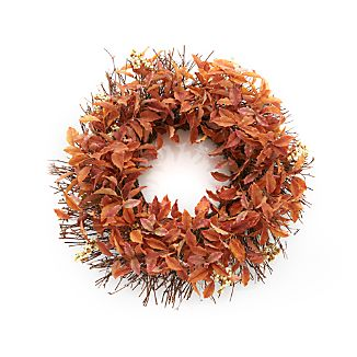 Realistic twigs of deep rust-hued leaves and white berries fashion a gorgeous wreath. Displayed on a covered front door or above the mantle, the wreath extends a warm fall welcome.