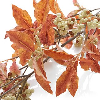 Deep rust-hued leaves and white berries adorn a realistic faux branch that brings beautiful fall colors right into your home all season long. Display in a tall vase in multiples to add drama to a fall entryway table or scatter on the autumn-themed table.