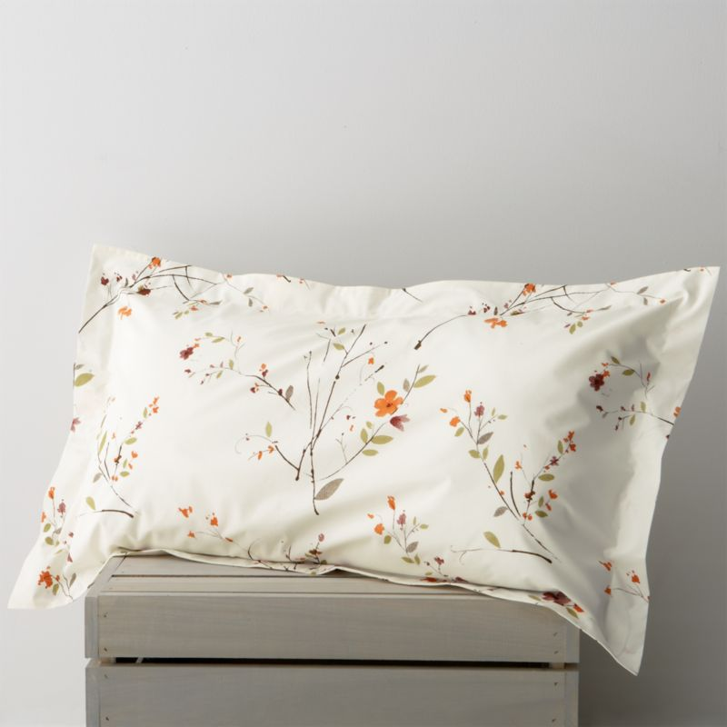 Ikebana inspiration for your personal space. A botanical pigment print in burnt oranges, greens and rust with brown branches is scattered across a soft white background. Flanged pillow sham has flap closure. Bed pillows also available.<br /><br /><NEWTAG/><ul><li>100% cotton</li><li>Soft 220-thread-count</li><li>Machine wash</li><li>Made in Portugal</li></ul><br />