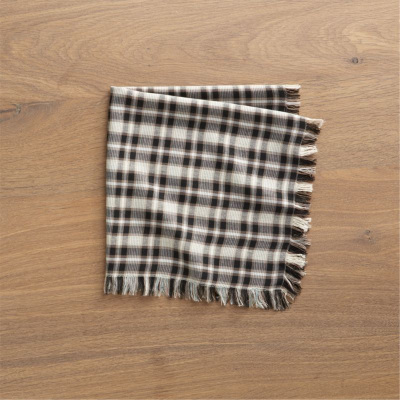 Yarn-dyed plaid threads together neutrals in a table-friendly napkin, fringed and edge-stitched on all sides.<br /><br /><NEWTAG/><ul><li>83% rayon, 12% cotton and 5% linen</li><li>Machine wash, dry flat; warm iron as needed</li><li>Made in India</li></ul>