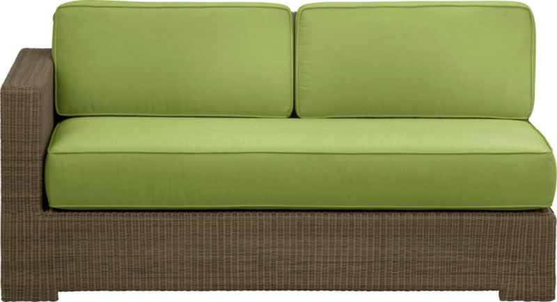 Ease into the new Sanibel lounge collection. With a breezy cabana look, resort-style seating is handwoven in all-weather resin wicker with warm honey and caramel tones. Small, tight weave wraps with precision over sturdy powdercoated aluminum. Modular group configures sectional arrangements to any size outdoor space. Deep cushions with self-welt detail are covered in fade- and mildew-resistant Sunbrella acrylic in a kiwi green.<br />After you place your order, we will send a fabric swatch via next day air for your final approval. We will contact you to verify both your receipt and approval of the fabric swatch before finalizing your order.<br /><br /><NEWTAG/><ul><li>Hand-woven, fade-resistant, recyclable resin wicker</li><li>Aluminum frame with powdercoat finish</li><li>For indoor or outdoor use</li><li>Cushions are fade- and mildew-resistant Sunbrella acrylic</li><li>Spot clean cushion</li><li>Made in Indonesia and USA</li></ul>