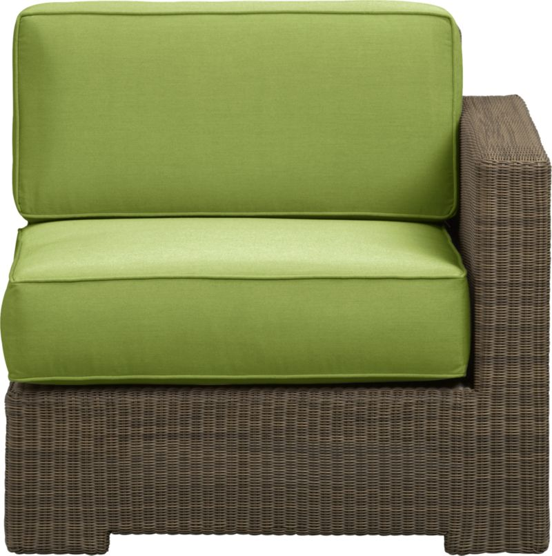 Ease into the Sanibel lounge collection. With a breezy cabana look, resort-style seating is handwoven in all-weather resin wicker with warm honey and caramel tones. Small, tight weave wraps with precision over sturdy powdercoated aluminum. Modular group configures sectional arrangements to any size outdoor space. Deep square cushions with self-welt detail are covered in fade- and mildew-resistant Sunbrella acrylic in kiwi green.<br />After you place your order, we will send a fabric swatch via next day air for your final approval. We will contact you to verify both your receipt and approval of the fabric swatch before finalizing your order.<br /><br /><NEWTAG/><ul><li>Hand-woven, fade-resistant, recyclable resin wicker</li><li>Aluminum frame with powdercoat finish</li><li>For indoor or outdoor use</li><li>Cushion is fade- and mildew-resistant Sunbrella acrylic</li><li>Spot clean cushion</li><li>Made in Indonesia and USA</li></ul>