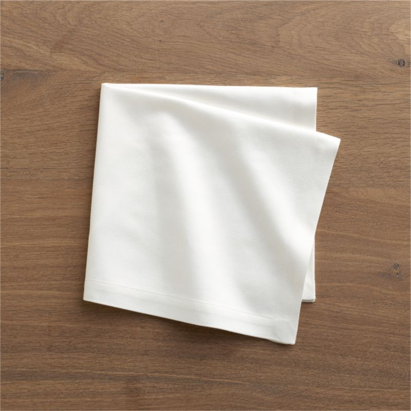 """Rayon/cotton blend sateen napkin complements casual and formal dining in versatile solids. Napkin is tailor finished with 1"""" hem.<br /><br /><NEWTAG/><ul><li>57% rayon and 43% cotton</li><li>Machine wash, tumble dry; warm iron as needed</li><li>Made in India</li></ul>"""