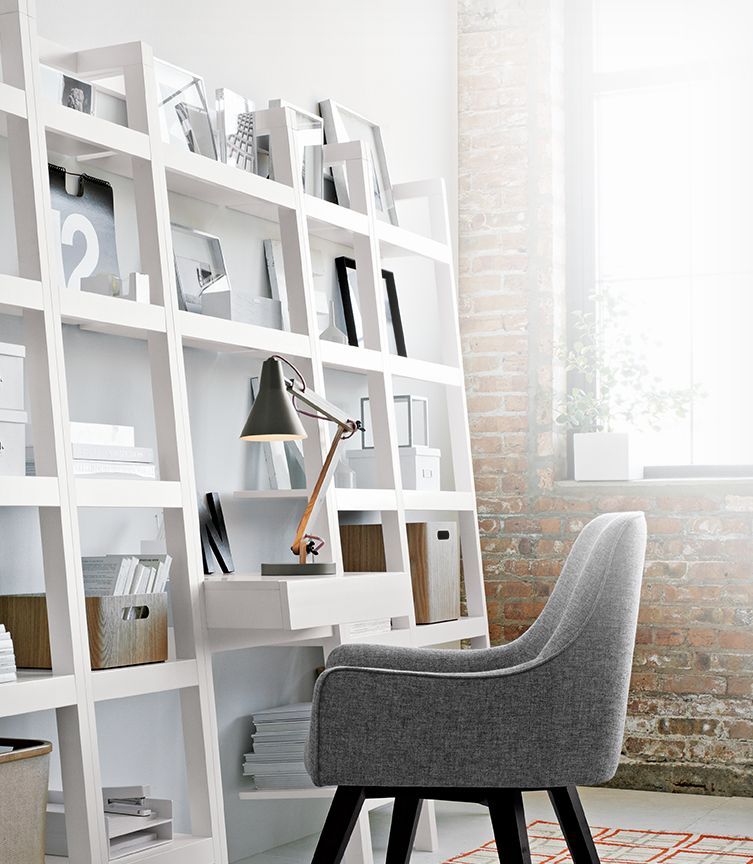 Sawyer white leaning bookshelves and desk with a Rex desk lamp and Harvey Desk chair, perfect for small areas. Shop Sawyer.