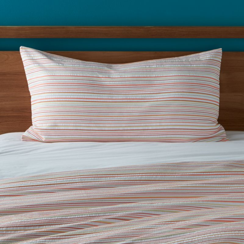 Sun-kissed stripes of coral and yellow freshen our Seaside cotton bedding with the summery crispness of seersucker. Reversible sham has envelope back closure. Bed pillows also available.<br /><br /><NEWTAG/><ul><li>100% cotton</li><li>Envelope back closure</li><li>Machine wash cold, tumble dry low</li><li>Made in Portugal</li></ul><br />