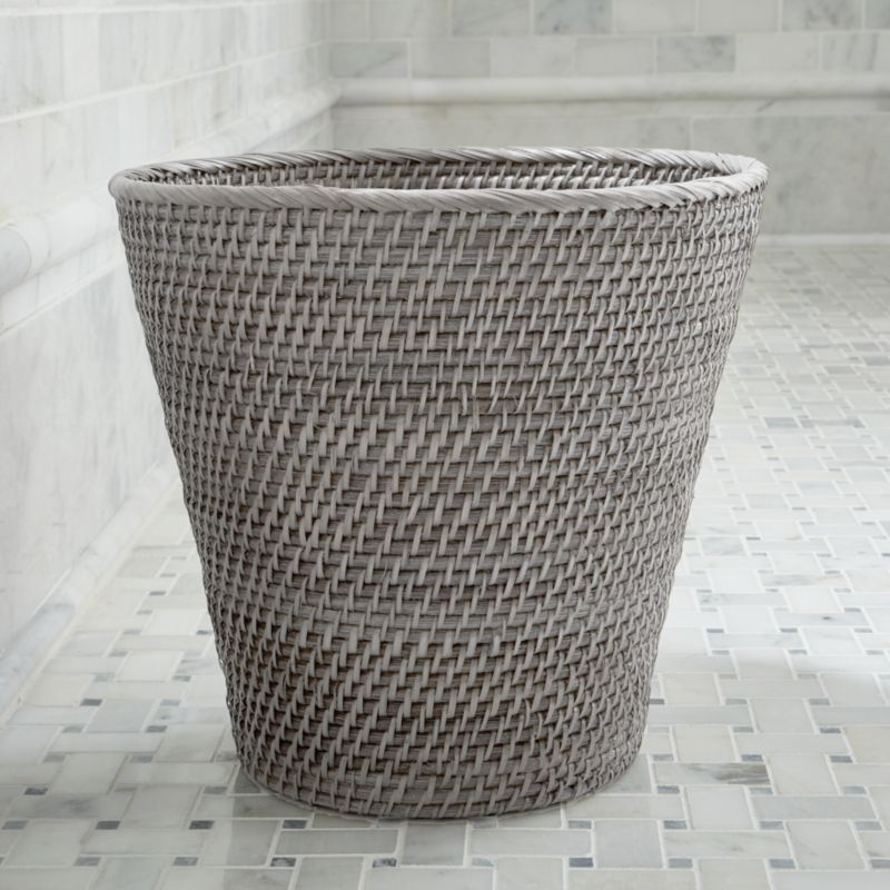 Tapered wastebasket takes care of the trash with loads of texture, handwoven of sturdy rattan and finished in warm grey.<br /><br /><NEWTAG/><ul><li>Handcrafted</li><li>100% rattan</li><li>Water-based, non-toxic grey lacquer finish</li><li>Made in The Philippines</li></ul>