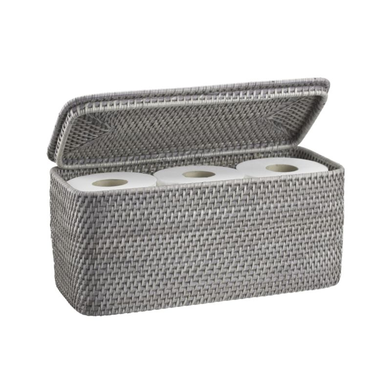 Rounded rectangle keeps a lid on toilet paper rolls or bathing sundries with loads of texture, handwoven of sturdy rattan and finished in warm grey.<br /><br /><NEWTAG/><ul><li>Handcrafted</li><li>100% rattan</li><li>Holds up to three rolls of toilet paper</li><li>Hinged lid</li><li>Water-based, non-toxic grey lacquer finish</li><li>Made in The Philippines</li></ul>