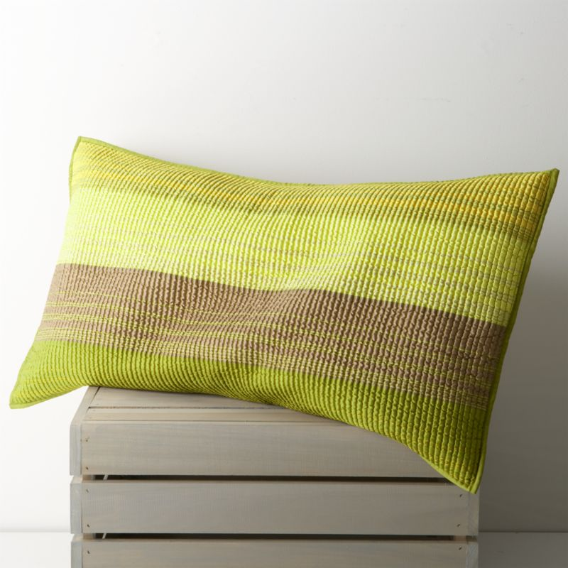 Rich desert hues of green and yellow sweep in horizontal bands, accented with hand-guided embroidery. Polyester topside brings out the sheen, reversing to solid green in soft cotton. Shams have neat self-hemmed edges and  generous overlapping closures on the back. Bed pillows also available.<br /><br /><NEWTAG/><ul><li>100% polyester front</li><li>100% cotton back and filling</li><li>100% rayon embroidery</li><li>Dry clean only</li><li>Made in India</li></ul>