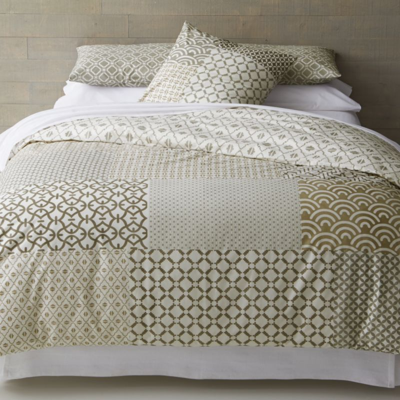 """An exquisite balance of graphic motifs is hand block-printed in a rich geometric """"patchwork"""" of soft, sophisticated neutrals. This early form of textile printing is considered one of the most artistic and time-consuming methods. Duvet inserts also available.<br /><br /><NEWTAG/><ul><li>100% cotton</li><li>Hand block-printed</li><li>Machine wash, tumble dry low</li><li>Made in India</li></ul>"""