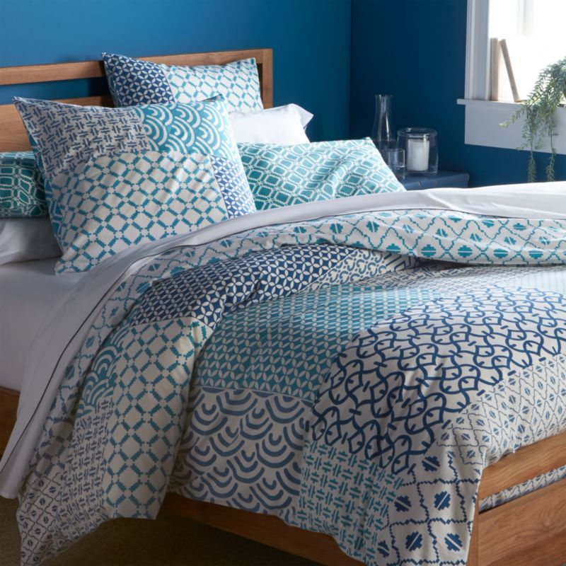 """An exquisite balance of graphic motifs is hand block-printed in a rich geometric """"patchwork"""" of soft, sophisticated blues. This early form of textile printing is considered one of the most artistic and time-consuming methods. Cover reverses to a single pattern and has a button closure and interior fabric ties to keep duvet insert in place. Duvet inserts also available.<br /><br /><NEWTAG/><ul><li>100% cotton</li><li>Hand block-printed</li><li>Interior fabric ties</li><li>Button closure</li><li>Machine wash, tumble dry low</li><li>Made in India</li></ul><br />"""