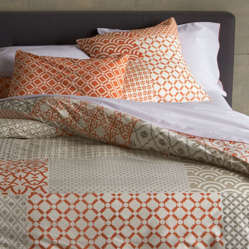 "An exquisite balance of graphic motifs is hand block-printed in a rich geometric ""patchwork"" of soft, sophisticated corals. This early form of textile printing is considered one of the most artistic and time-consuming methods. Cover reverses to a single pattern and has a button closure and interior fabric ties to keep duvet insert in place. Duvet inserts also available.<br /><br /><NEWTAG/><ul><li>100% cotton</li><li>Hand block-printed</li><li>Interior fabric ties</li><li>Button closure</li><li>Machine wash, tumble dry low</li><li>Made in India</li></ul><br />"