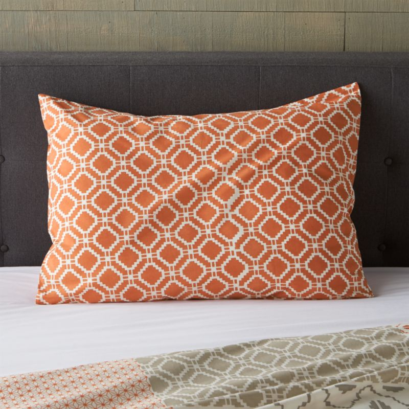 "An exquisite balance of graphic motifs is hand block-printed in a rich geometric ""patchwork"" of soft, sophisticated corals. This early form of textile printing is considered one of the most artistic and time-consuming methods.  Shams have an all-over print and overlapping back closure. Bed pillows also available.<br /><br /><NEWTAG/><ul><li>100% cotton</li><li>Hand block-printed</li><li>Overlapping back closure</li><li>Machine wash, tumble dry low</li><li>Made in India</li></ul><br />"
