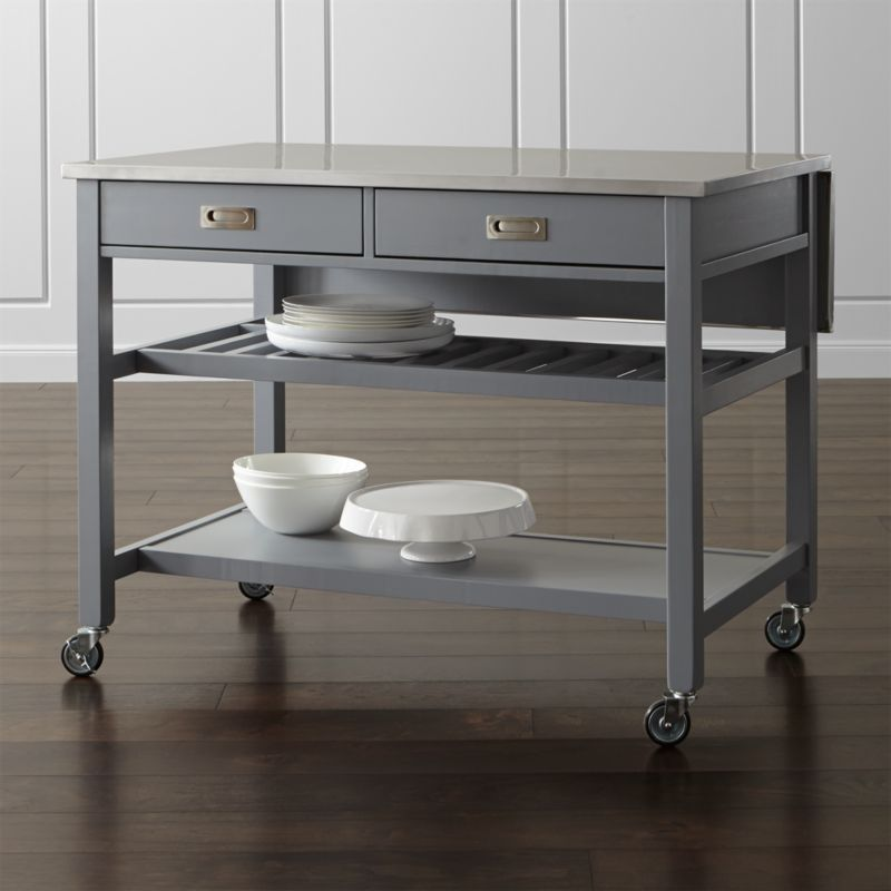 Our Sheridan kitchen island instantly expands your kitchen's work surface and storage with form, function and versatility. The stainless-steel top is a dream—durable and easy to clean—and rests on a solid base atop casters, making it easy to move when needed. <NEWTAG/><ul><li>Designed by Bill Eastburn of William Eastburn Design</li><li>Base, legs, stretchers and slatted shelf are solid rubberwood painted finish and clear topcoat</li><li>Stainless-steel top over engineered wood</li><li>2 fixed bottom shelves, 1 solid and 1 slatted</li><li>2 towel bars</li><li>Drop-down leaf</li><li>2 drawers with wood glides and stainless steel pulls</li><li>4 casters (2 locking) or optional wood feet</li><li>Made in Thailand</li></ul><br />