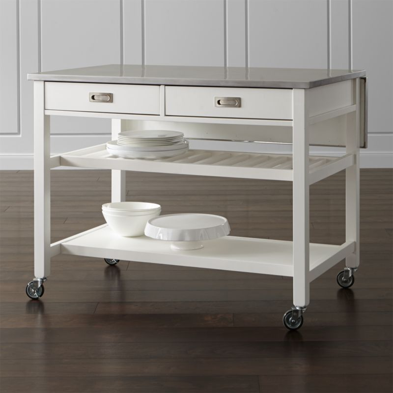 Instantly expand your kitchen's work surface and storage with form, function and versatility. Designed by Bill Eastburn, the Sheridan kitchen island's stainless-steel top is a dream—durable and easy to clean—and rests on a solid base atop casters, making it easy to move when needed. <NEWTAG/><ul><li>Designed by Bill Eastburn of William Eastburn Design</li><li>Base, legs, stretchers and slatted shelf are solid rubberwood painted finish and clear topcoat</li><li>Stainless-steel top over engineered wood</li><li>2 fixed bottom shelves, 1 solid and 1 slatted</li><li>2 towel bars</li><li>Drop-down leaf</li><li>2 drawers with wood glides and stainless steel pulls</li><li>4 casters (2 locking) or optional wood feet</li><li>Made in Thailand</li></ul><br />