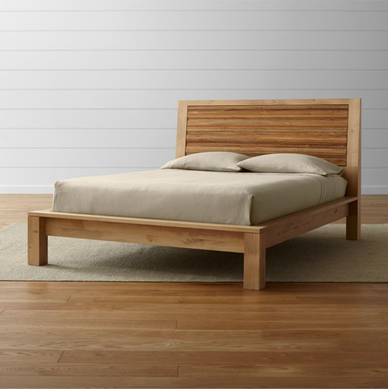 "Our Sierra queen platform bed combines repurposed teak and oak's natural beauty in an eco-friendly union. A textured paneled headboard is crafted from strips of teak, salvaged from spare production materials and steel-brushed to highlight the grain's tone and texture. <NEWTAG/><ul><li>Solid European white oak frame finished with oil and wax</li><li>Solid, steel-brushed repurposed teak headboard finished with clear topcoat</li><li>As with all solid woods, expansion and contraction may occur with seasonal changes in humidity</li><li>13 slats with 1 center support leg</li><li>Platform bed designed for use with mattress only</li><li><a href=""/furniture/mattresses-foundations/1"">Mattresses</a> and optional <a href=/bunky-board/f30646>bunky board</a> available (sold separately)</li><li>Maximum weight capacity: 800 pounds (includes weight of mattress and occupants)</li><li>Made in Vietnam</li></ul>"