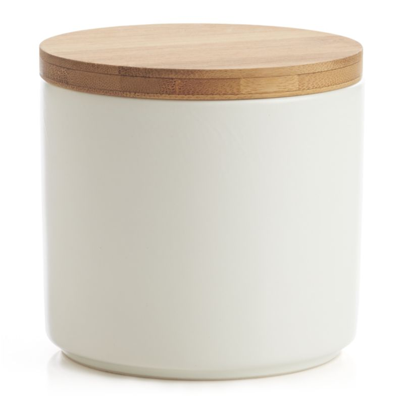 Clean, contemporary styling in durable stoneware, warmed by a winter-white glaze and natural bamboo lid. Silicone lid gasket forms a tight seal, locking in freshness and locking out moisture. Stackable canisters store staples in style on the countertop or pantry.<br /><br /><NEWTAG/><ul><li>Stoneware</li><li>Matte glaze finish</li><li>Bamboo lid with silicone gasket</li><li>BPA-free</li><li>Canister is dishwasher-safe</li><li>Hand wash the bamboo lid</li><li>Bamboo lid will darken in color over time</li><li>Made in China</li></ul><br />