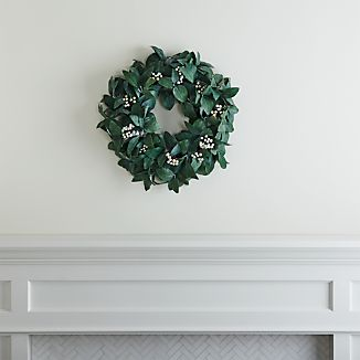 Lifelike silvery green sage leaves and white berries craft a full wreath for the front door or to encircle a hurricane candle holder.