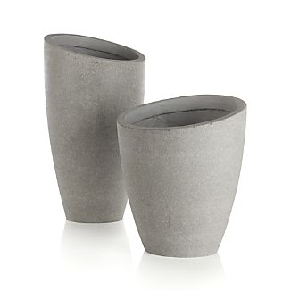 A slight slant to the rim trends these planters from the expected to the delightfully different. Statement pieces flank the door for a contemporary welcome or stage them together, short and tall, for a dynamic display of potted plants. Crafted of a lightweight combination of fiberglass, cement and sand that works indoors or out.Fiberglass, cement and sandDrainage holeFor use indoors or outProtect from freezing temperaturesMade in Vietnam