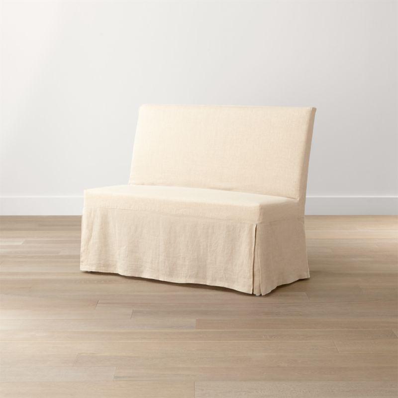 Our streamlined Slip Bench offers casual, open seating with a comfortably angled back and natural-linen slipcover. <NEWTAG/><ul><li>Solid beechwood frame</li><li>Webbing suspension system</li><li>Polyfoam cushion seat and back</li><li>Base is covered in 100 percent cotton muslin</li><li>Removable 100 percent linen slipcover</li><li>Seats 2</li><li>Made in China and India</li></ul><br />