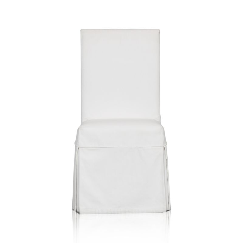 Custom-fitted, washable slipcover is expertly tailored with box pleats and a clever panel that secures the cover to our Slip Side Chair (sold separately) with self-adhesive tab closures.<br /><br /><NEWTAG/><ul><li>100% cotton canvas</li><li>Machine washable</li><li>Made in India</li></ul><br /><br />