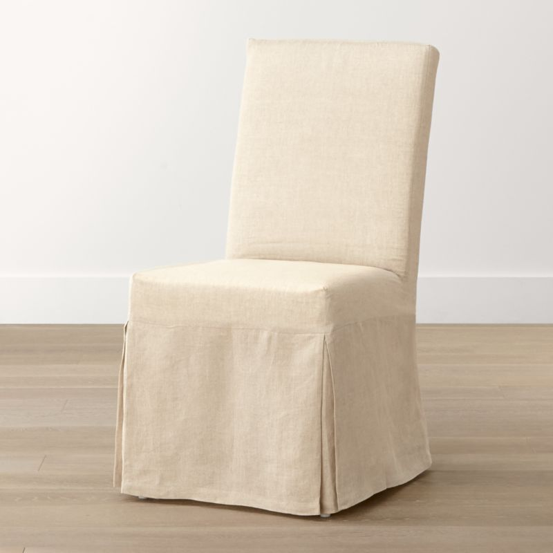 Relaxed and versatile with a comfortably angled back and natural-linen slipcover, this streamlined, open side chair works well in a variety of rooms and settings. <NEWTAG/><ul><li>Solid beechwood frame</li><li>Webbing suspension system</li><li>Polyfoam cushion seat and back</li><li>Base is covered in 100 percent cotton muslin</li><li>Removable 100 percent linen slipcover</li><li>Made in China</li></ul><br />
