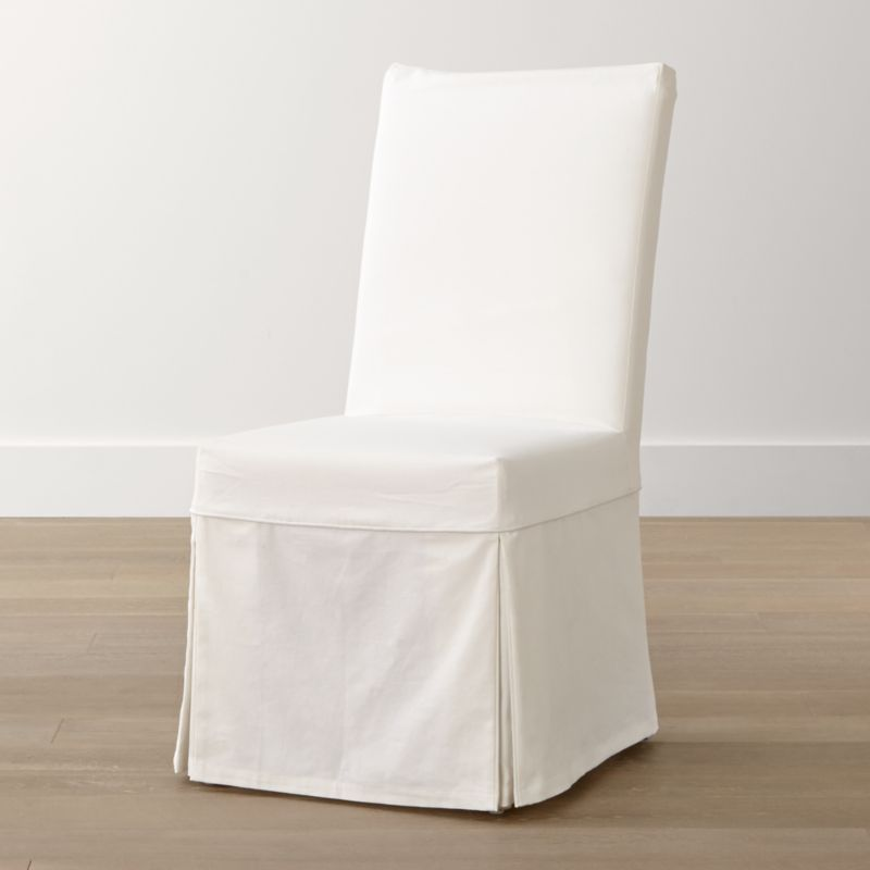 A streamlined, open profile with a comfortably angled back and machine-washable cotton slipcover allows this relaxed, versatile side chair to work well in a variety of rooms and settings. <NEWTAG/><ul><li>Solid beechwood frame</li><li>Webbing suspension system</li><li>Polyfoam cushion seat and back</li><li>Base is covered in 100 percent cotton muslin</li><li>Removable 100 percent cotton slipcover</li><li>Made in China</li></ul><br />