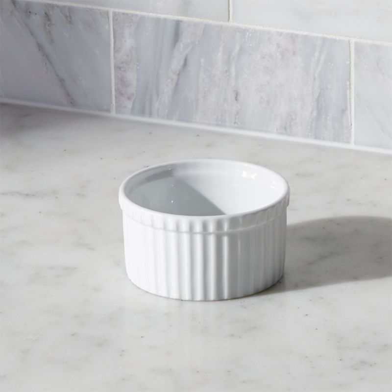 Durable, ribbed white porcelain ramekins add classic style to a variety of foods. Small ramekin can be used to make individual desserts, serve snacks or pre-measure cooking ingredients mise en place—the uses are endless.<br /><br /><NEWTAG/><ul><li>Durable white porcelain</li><li>Oven to table</li><li>Dishwasher-, microwave-, oven-, broiler- and freezer-safe</li><li>Made in Vietnam</li></ul>