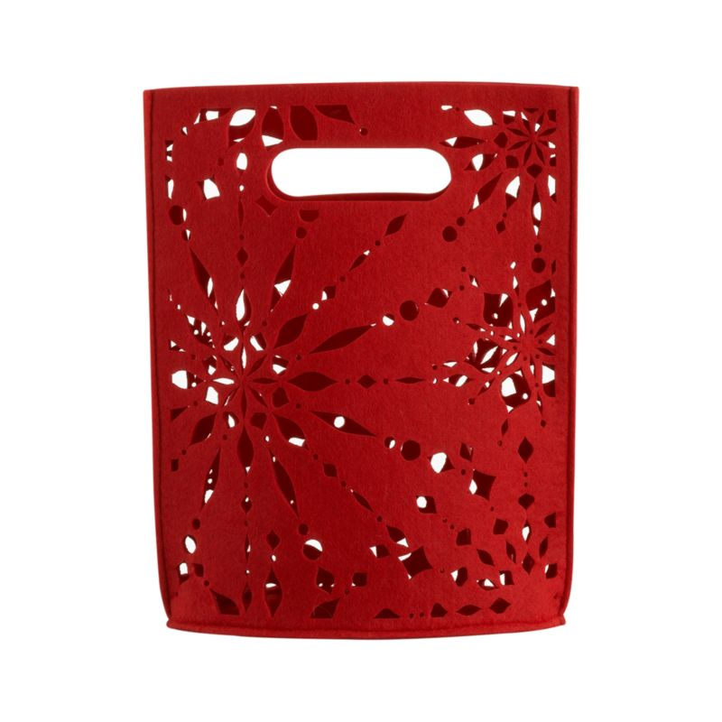 Our exclusive snowflake pattern cuts a festive flurry in red felt tote. Insert a gift or two and a puff of tissue paper for a dazzling gift to go.<br /><br /><NEWTAG/><ul><li>Polyester felt</li><li>Exclusive design</li></ul>