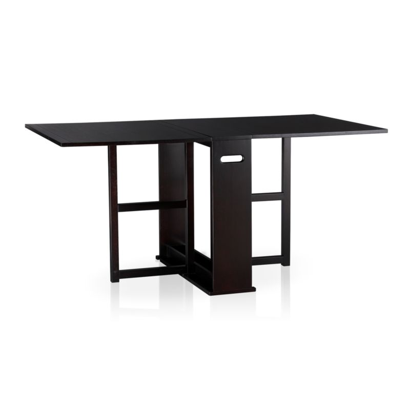 """An ingenious classic for modern times, our slender gateleg table opens to a generous 65½"""" wide to accommodate up to four guests, then folds up to a slim 9½"""" wide to stow away until your next gathering. Compact design can also function as a sleek console against a wall. Wood construction with an oak veneer tabletop and dark espresso stain.<br /><br /><a href=""""/Assembly-Instructions/English/Span_Gateleg_Table.pdf"""">Important operational instructions (PDF format).</a><br /><br /><NEWTAG/><ul><li>Tabletop is oak veneer and low-emission engineered wood with solid rubberwood edge banding</li><li>Frame and legs are sustainable solid rubberwood</li><li>Dark espresso stain</li><li>Seats up for four</li><li>Made in China</li></ul>"""