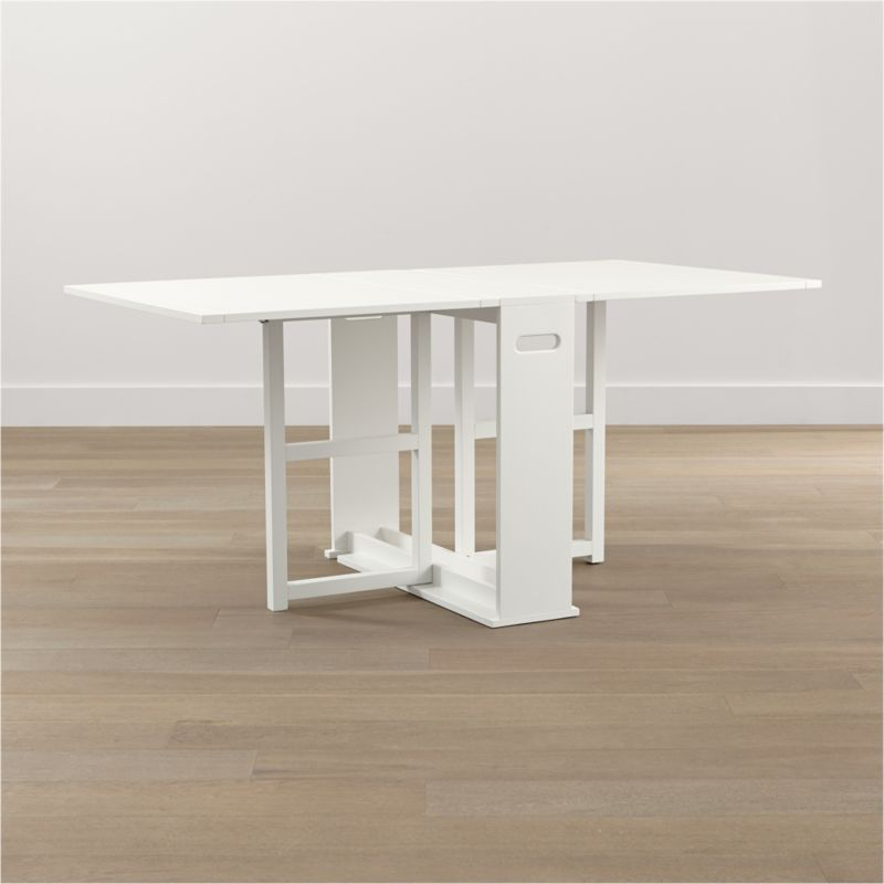 "An ingenious classic for modern times, our slender gateleg table opens to a generous 65½"" wide accommodate up to four guests, then folds up to a slim 9½"" wide to stow away until your next gathering. Compact design can also function as a sleek console against a wall. Wood construction with an oak veneer tabletop and semigloss white lacquer finish.<br /><br /><a href=""/Assembly-Instructions/English/Span_Gateleg_Table.pdf"">Important operational instructions (PDF format).</a><br /><br /><NEWTAG/><ul><li>Tabletop is oak veneer and low-emission engineered wood with solid rubberwood edge banding</li><li>Frame and legs are sustainable solid rubberwood</li><li>Semigloss white lacquer finish</li><li>Seats up to four</li><li>Made in China</li></ul>"