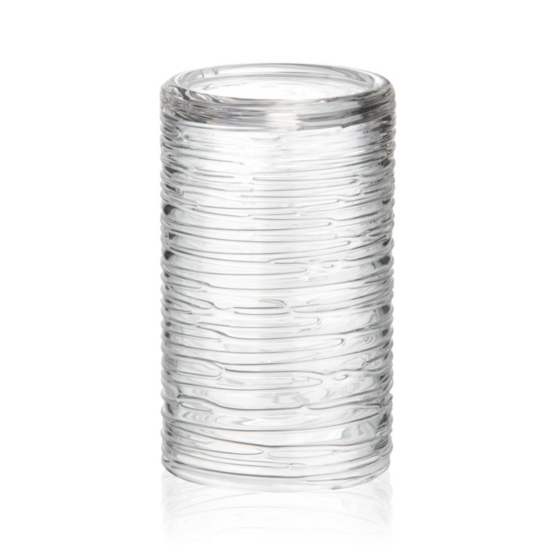 "Spun glass cylinders with distinctive organic texture create a dramatic candlelight glow or showcase for fresh flowers<br /><br /><NEWTAG/><ul><li>Handmade and molded glass</li><li>Accommodates up to a 3""x6"" pillar candle, sold separately</li><li>Hand wash</li><li>Made in Thailand</li></ul>"