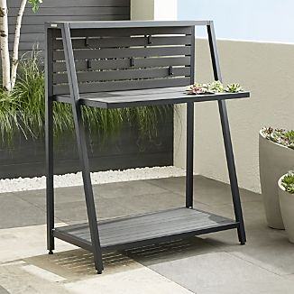 This multipurpose outdoor work station multitasks in the backyard, garage or screened porch. The Splay work station angles an open aluminum base in black to frame slats of weather-resistant polystyrene with the look of real wood.