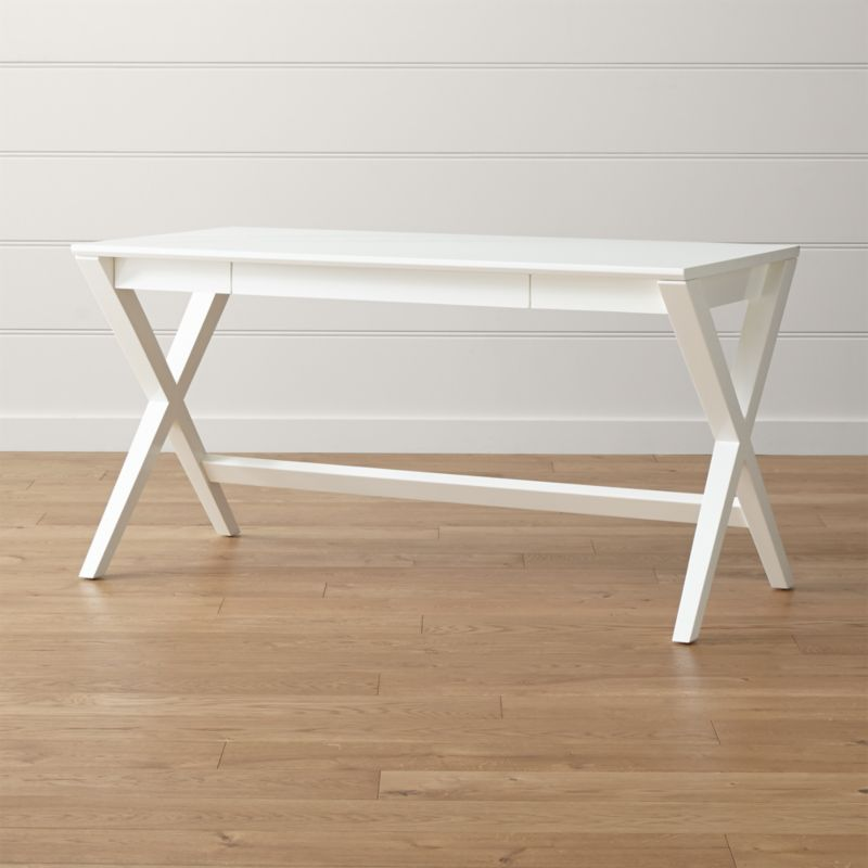 The classic campaign desk takes a contemporary, refined turn in crisp white with Spotlight. Crossed legs support a sleek tabletop with a slim, wide drawer that slides out to reveal smart storage and flips into a work surface. <NEWTAG/><ul><li>Designed by Mark Daniel of Slate</li><li>Solid hardwood frame</li><li>Ash veneer top with solid wood edge banding</li><li>White lacquer and protective topcoat</li><li>Made in Vietnam</li></ul><br />