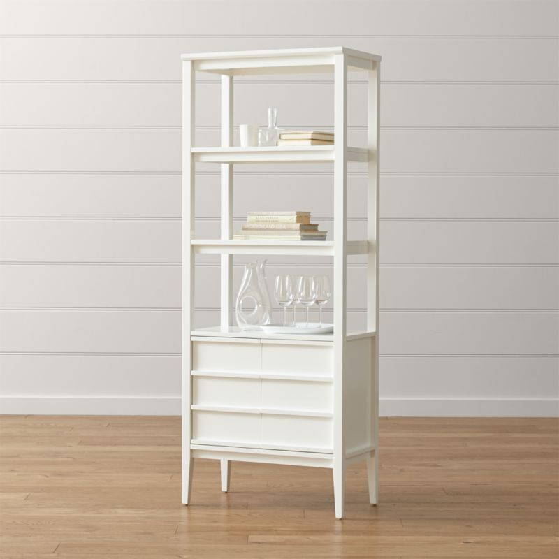 Clean-lined and sleek in a high-gloss white finish, Spotlight highlights simple, smart storage. The freestanding bookcase offers two upper shelves for display and a closed storage cabinet below. <NEWTAG/><ul><li>Designed by Mark Daniel of Slate</li><li>Solid and engineered wood and ash veneer frame</li><li>White lacquer and protective topcoat</li><li>One adjustable and two fixed shelves</li><li>Made in Vietnam</li></ul><br />