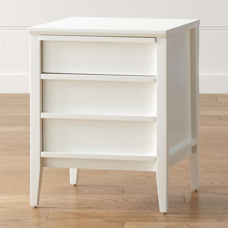 Simple lines and smart storage define the sleek white Spotlight. Pull the concealed cutaway handles open to reveal generous space for files and supplies. <NEWTAG/><ul><li>Designed by Mark Daniel of Slate</li><li>Solid and engineered wood and ash veneer</li><li>White lacquer and protective topcoat</li><li>Two drawers</li><li>Made in Vietnam</li></ul><br />
