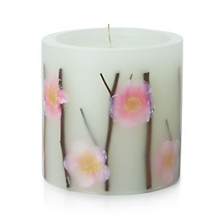 Gorgeous springtime candle is adorned with decorative pink flowers and twigs to create a garden-inspired look. A thoughtful gift for the Easter hostess or as a Mother's Day present.