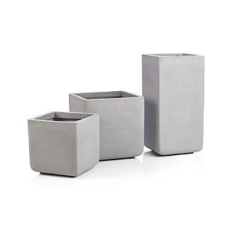 Our handsome square planters look as if they were made of heavy concrete, but their lightweight mix of fiberglass, cement and sand make them easy to position.  Neutral and modern, the planter assumes a square profile, with just a hint of curve at the base to make things interesting.Fiberglass, cement and sandDrainage holeFor indoor or outdoor useProtect from freezing weatherRemove soil before storing in freezing weather to avoid cracking.Made in Vietnam
